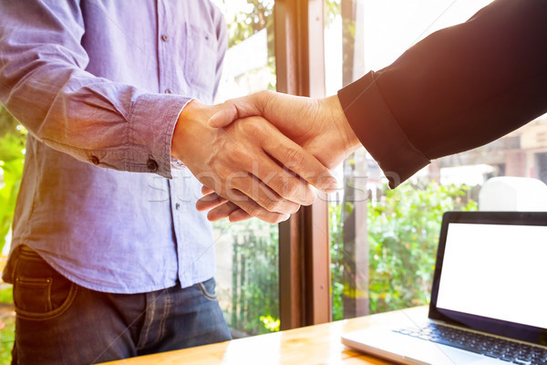 Two business men shaking hands Stock photo © snowing