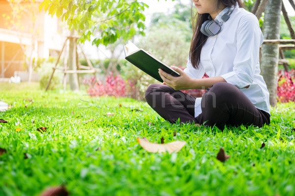 Pretty relaxed young beautiful woman reading a book in the garde Stock photo © snowing