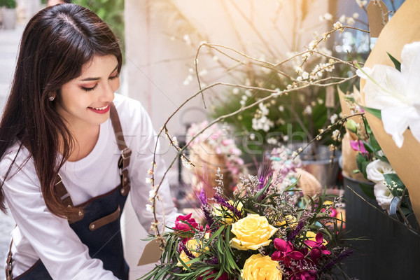 young women business owner florist making bouquet  in front of f Stock photo © snowing