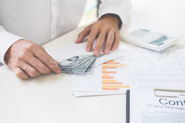 business man counting money at the table  accounting concept Stock photo © snowing