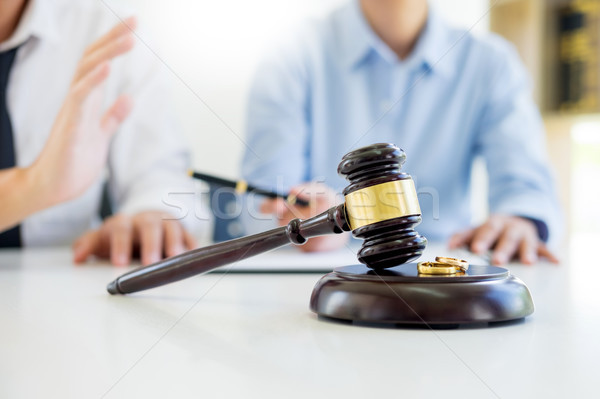 Angry couple arguing telling their problems to Judge gavel decid Stock photo © snowing