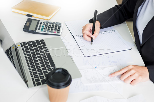 Stock photo: business woman accountant or banker making calculations Bills. d