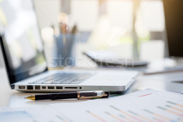 Business desk with a keyboard, report graph chart, pen and table Stock photo © snowing