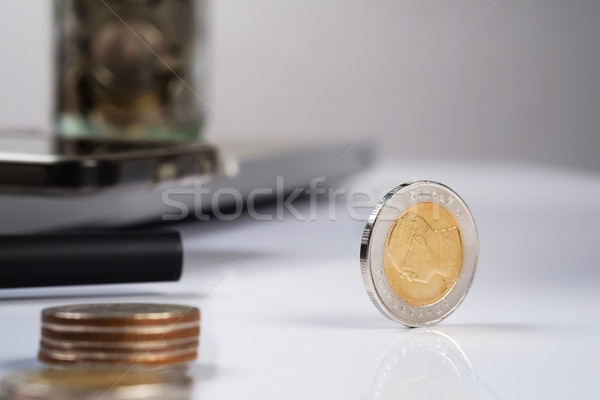 busines, finance, money and bookkeeping concept - coins on offic Stock photo © snowing