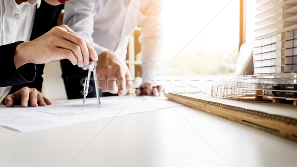 Person's engineer Hand Drawing Plan On Blue Print with architec Stock photo © snowing