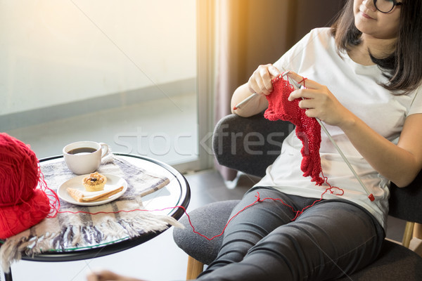 young woman's hands knitting warm sweaters. Sitting on old arm Stock photo © snowing
