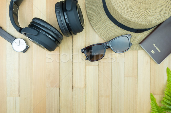 Stock photo: Essential traveler items accessories, tropical leaf on wood back