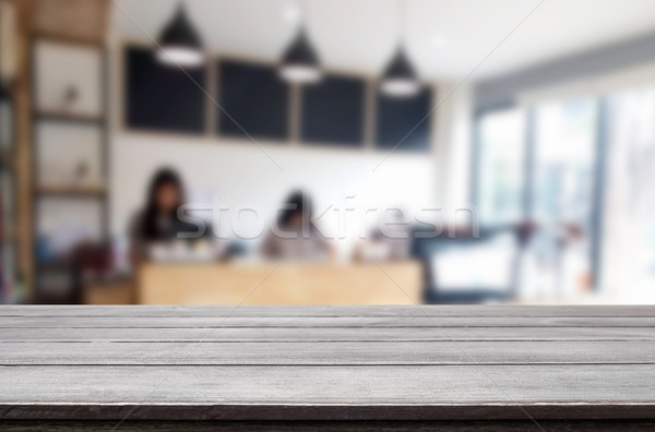 Selected focus empty brown wooden table and Coffee shop blur bac Stock photo © snowing