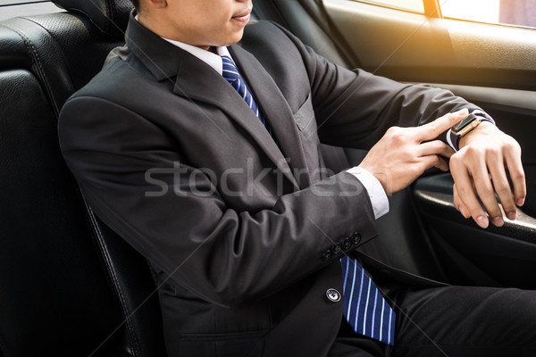 Jóképű üzletember néz karóra autó iroda Stock fotó © snowing
