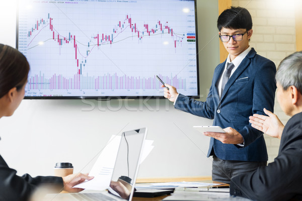 Business man speaker giving a talk stock profit graph presentati Stock photo © snowing