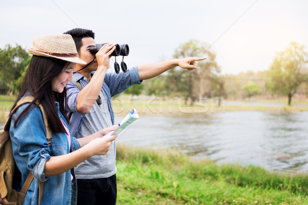 Outdoor shot of happy young loving couple hikers at valley of th Stock photo © snowing