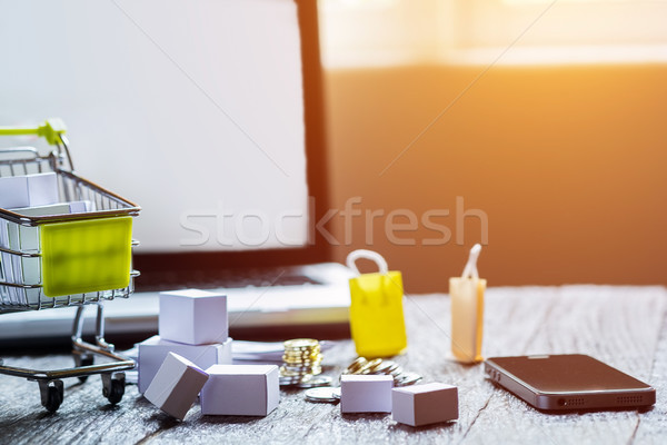 laptop blank screen and hopping cart full of gifts with copyspac Stock photo © snowing