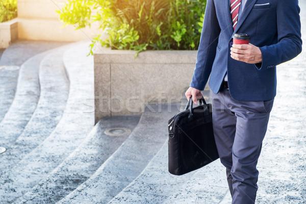 фотография молодые деловой человек ходьбе вперед Сток-фото © snowing