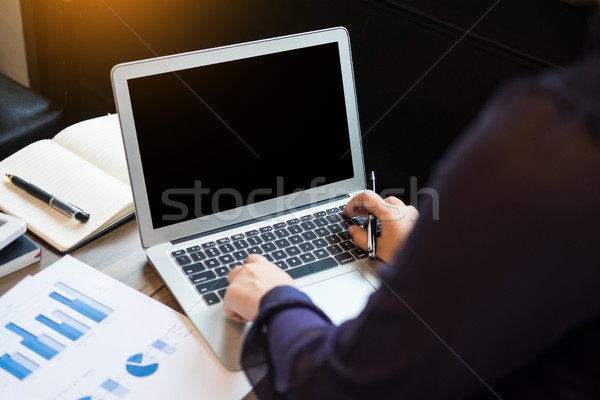 Closeup of Young business man working at office with laptop and  Stock photo © snowing