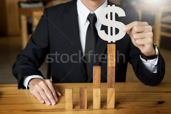 Concept growing value. hand of businessman pick up dollars symbo Stock photo © snowing