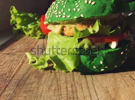 Egzotikus zöld hamburger zsemle szezámmag paradicsom Stock fotó © softulka