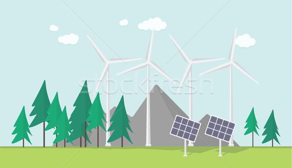 Eco dizayn fırıldak güneş panelleri dağlar Stok fotoğraf © softulka