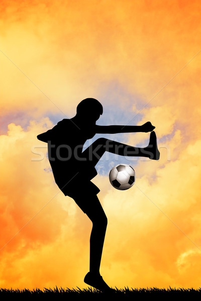 Soccer player at sunset Stock photo © sognolucido
