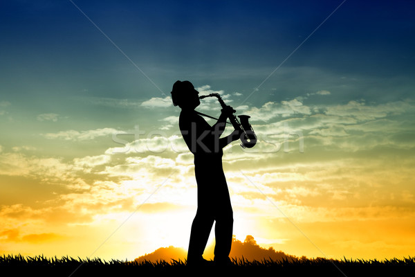 Saxophonist at sunset Stock photo © sognolucido