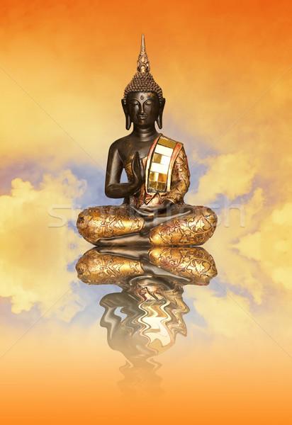 Buddha statuette at sunset Stock photo © sognolucido