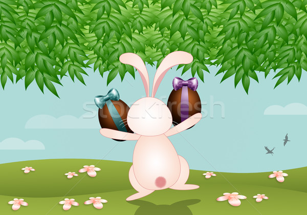Bunny with chocolate eggs for Easter Stock photo © sognolucido
