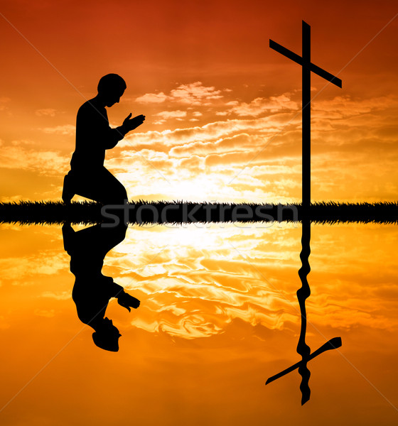 Man praying under the cross Stock photo © sognolucido