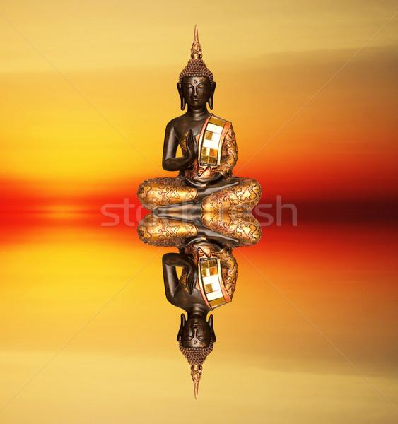 Buddha statue at sunset Stock photo © sognolucido