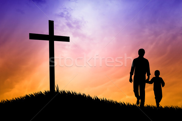 Stock photo: Father and son under the cross