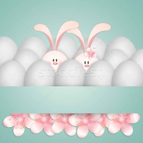Bunny couple in the middle of eggs Stock photo © sognolucido