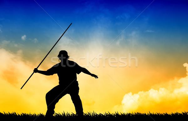 Shaolin man at sunset Stock photo © sognolucido
