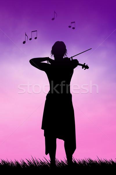 Violinist at sunset Stock photo © sognolucido