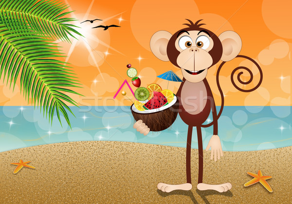 Monkey with coconut cocktail on the beach Stock photo © sognolucido
