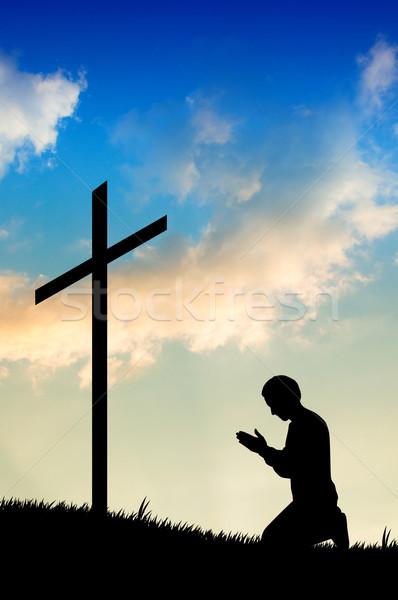 Man praying under the cross Stock photo © sognolucido