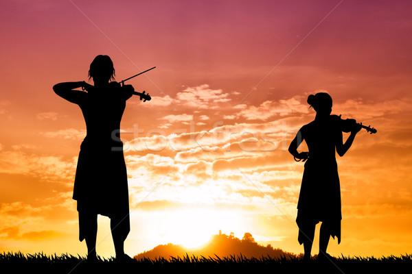 Violinist women at sunset Stock photo © sognolucido
