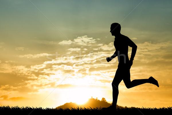 を実行して 男 実例 ジョギング 日没 速度 ストックフォト © sognolucido