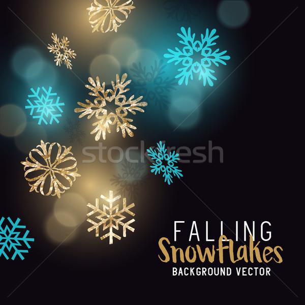 Gold glittering winter snowflakes Stock photo © solarseven