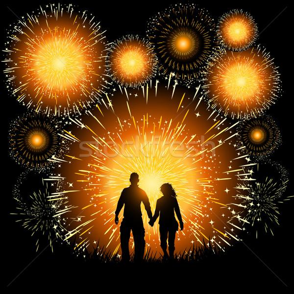 Feux d'artifice couple regarder incroyable écran Photo stock © solarseven