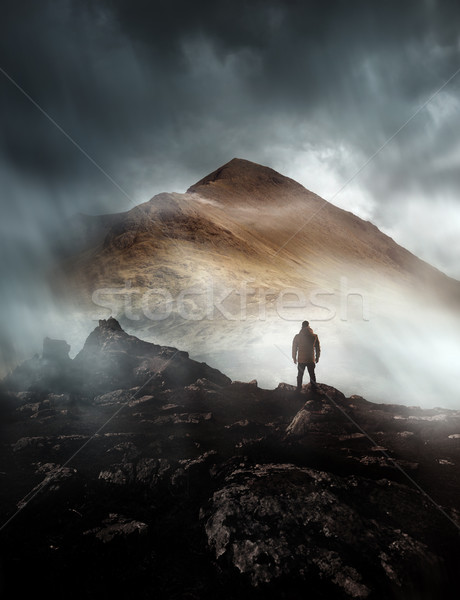 Stock photo: Man Hiking On A Misty Mountain