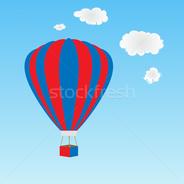Globo de aire caliente rojo blanco azul cielo nubes Foto stock © soleilc