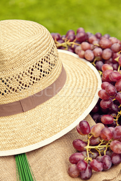 Straw hat and red grapes Stock photo © sophie_mcaulay