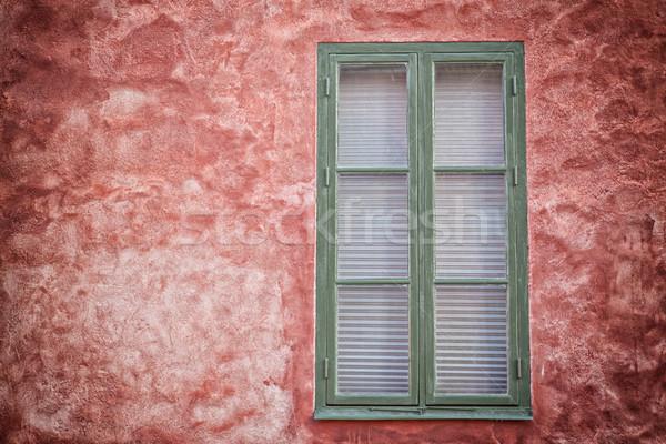 Green window on red wall. Stock photo © sophie_mcaulay