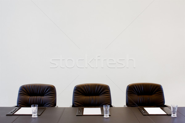 The boardroom table is set for a meeting Stock photo © SophieJames