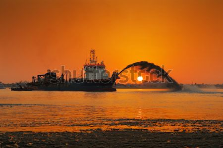 A dredging ship in action at Palm Jumeirah, Dubai, UAE Stock photo © SophieJames