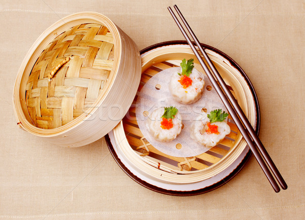 Chinese seafood dumplings garnished with red caviar and parsley Stock photo © SophieJames