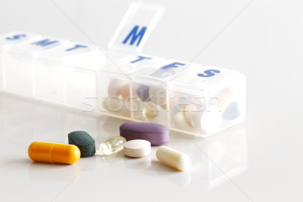 A weekly container of tablets, vitamins etc Stock photo © SophieJames
