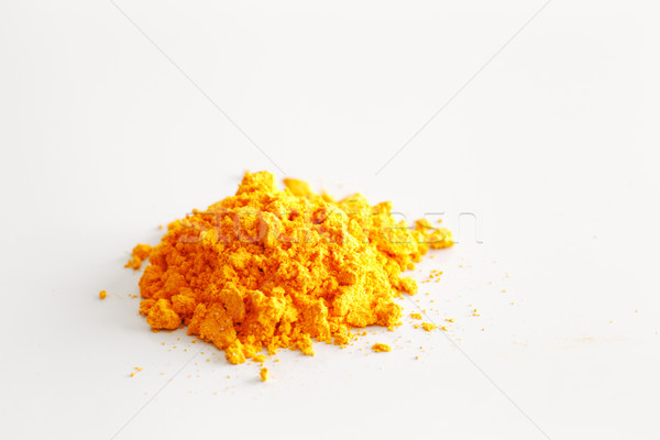 The contents of a single turmeric capsule on white surface Stock photo © SophieJames