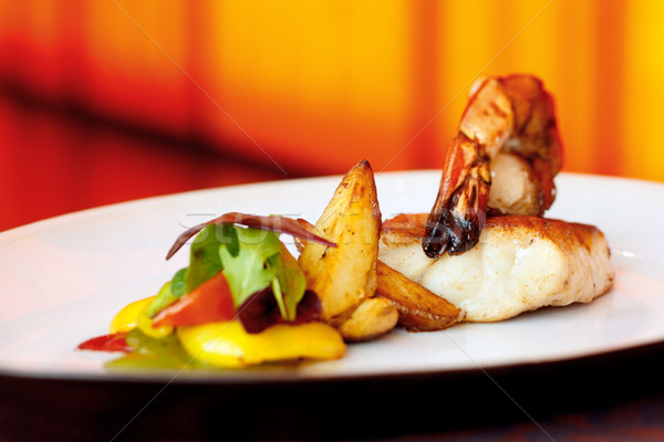 Seafood king prawn served with cod and roasted wedges Stock photo © SophieJames