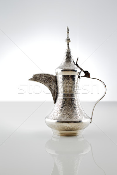 An ornate dallah which is a metal pot for making Arabic coffee Stock photo © SophieJames