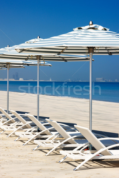 Reclining deck chairs on the beach Stock photo © SophieJames