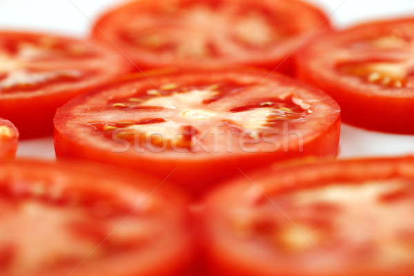 A few slices of organic vine tomatoes shot Stock photo © SophieJames